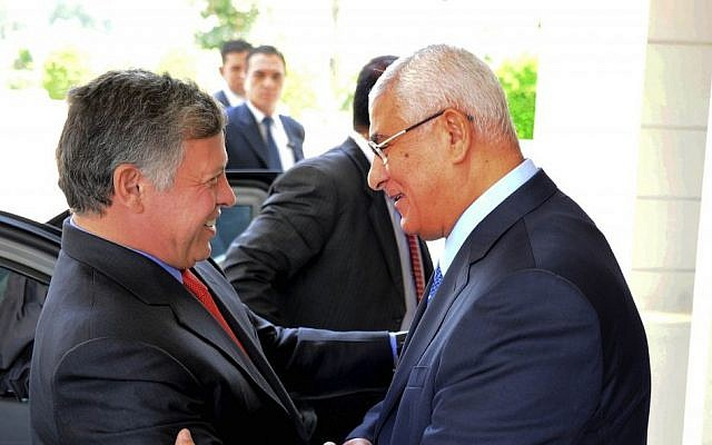 Egyptian President Adly Mansour, right, greets Jordan's King Abdullah II on his arrival to the presidential palace, Saturday, July 20 (photo credit: AP/Egyptian Presidency)