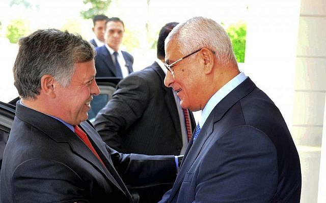 In this image released by the Egyptian presidency, Egyptian President Adly Mansour, right, greets Jordan's King Abdullah II on his arrival to the presidential palace, Saturday, July 20, 2013 (photo credit: AP)
