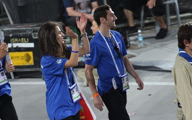 Carole Dwek claps with the Maccabiah crowd as she marches with Belgium delegation at the opening ceremony (photo courtesy Carole Dwek)