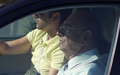 Former defense minister Costas Papacostas, front, is seen in a car as he arrives at the court in southern city of Larnaca, Cyprus, on Tuesday, July 9, 2013. (photo credit: AP Photo/Andreas Lazarou)