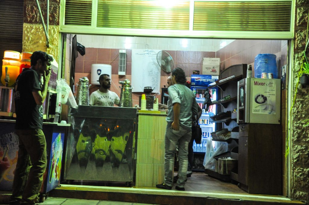 Cab drivers frequent Amman's little coffee-to-go shops, which have busboys who bring people their drinks (photo credit: Michal Shmulovich/Times of Israel)