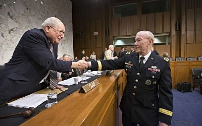 Gen. Martin Dempsey, chairman of the Joint Chiefs of Staff, right, greets Senate Armed Services Committee Chairman Carl Levin, D-Mich., left, as he appears before the committee for a hearing to consider his reappointment to the military's highest post, on Capitol Hill in Washington, Thursday, July 18, 2013 (photo credit: AP/J. Scott Applewhite)