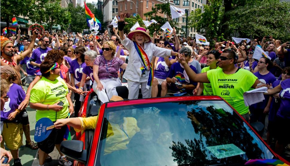 Grand Marshal Edith Windsor, the 84-year-old woman at the center of the US Supreme Court decision granting gay couples federal marriage benefits, is surrounded by well-wishers during the gay pride march in New York on Sunday, June 30, 2013. (photo credit: AP Photo/Craig Ruttle)