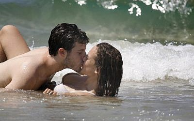 Illustrative photo of a couple kissing at the beach. (Nati Shohat/Flash90)