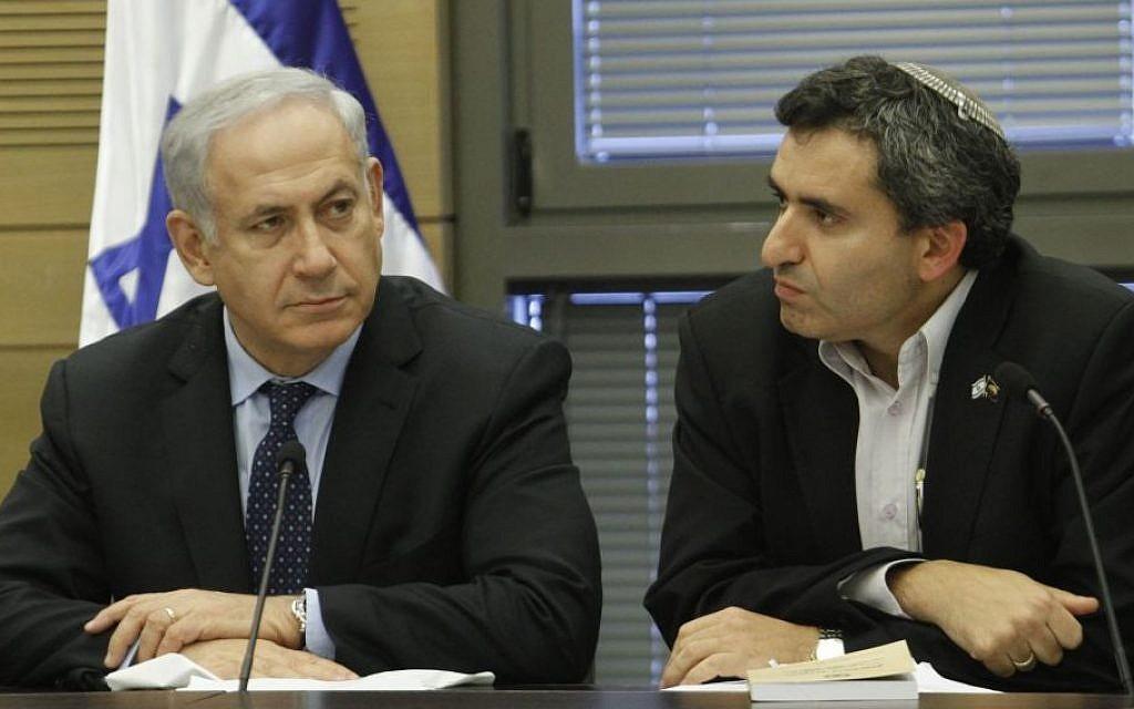 Prime Minister Benjamin Netanyahu and Immigration Minister Ze'ev Elkin. (Miriam Alster/Flash90)