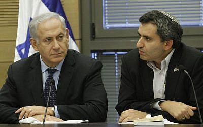 Prime Minister Benjamin Netanyahu and Deputy Foreign Minister Ze'ev Elkin at a Likud party meeting in the Knesset, July 2013. (photo credit: Miriam Alster/Flash90)