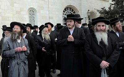 Ultra-Orthodox men pray in front of the Jerusalem Police headquarters in 2012 (photo credit: Flash90)