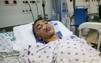 Jamal Julani lies in intensive care at Hadassah Ein Karem hospital after Jewish youths attacked him and his friends in the center of Jerusalem. August 18, 2012. (photo credit: Oren Nahshon/FLASH90)