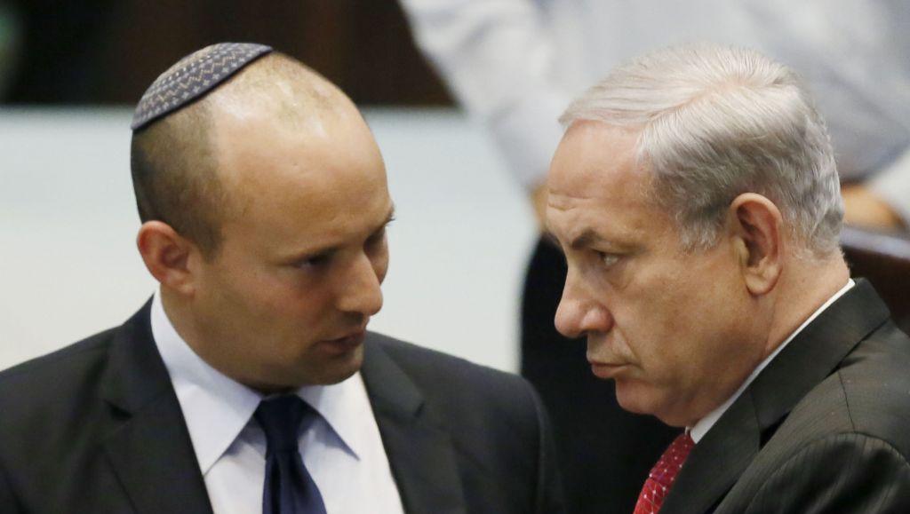 Jewish Home leader Naftali Bennett with Prime Minister Benjamin Netanyahu in the Knesset, April 22, 2013 (Miriam Alster/Flash90)