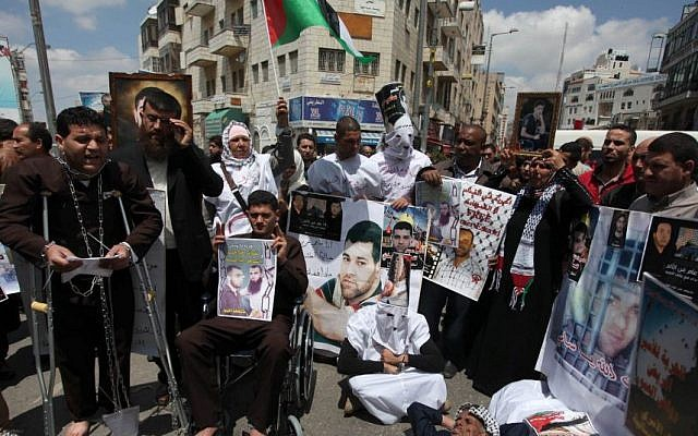 Relatives of Palestinians prisoners take part in a protest calling for their release, in Ramallah in April (Photo credit: Issam Rimawi/Flash90)