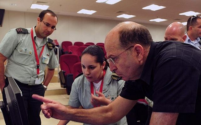 An illustrative photo of Defense Minister Moshe Ya'alon visiting the governmental department of telecom and cyber systems in June 2013 (Ariel Hermoni/Ministry of Defense/Flash90)