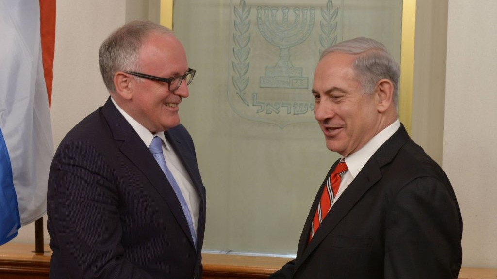 PM Benjamin Netanyahu (right), with Dutch FM Frans Timmermans in Jerusalem on June 17, 2013. (photo credit: Amos Ben Gershom/GPO/Flash90)