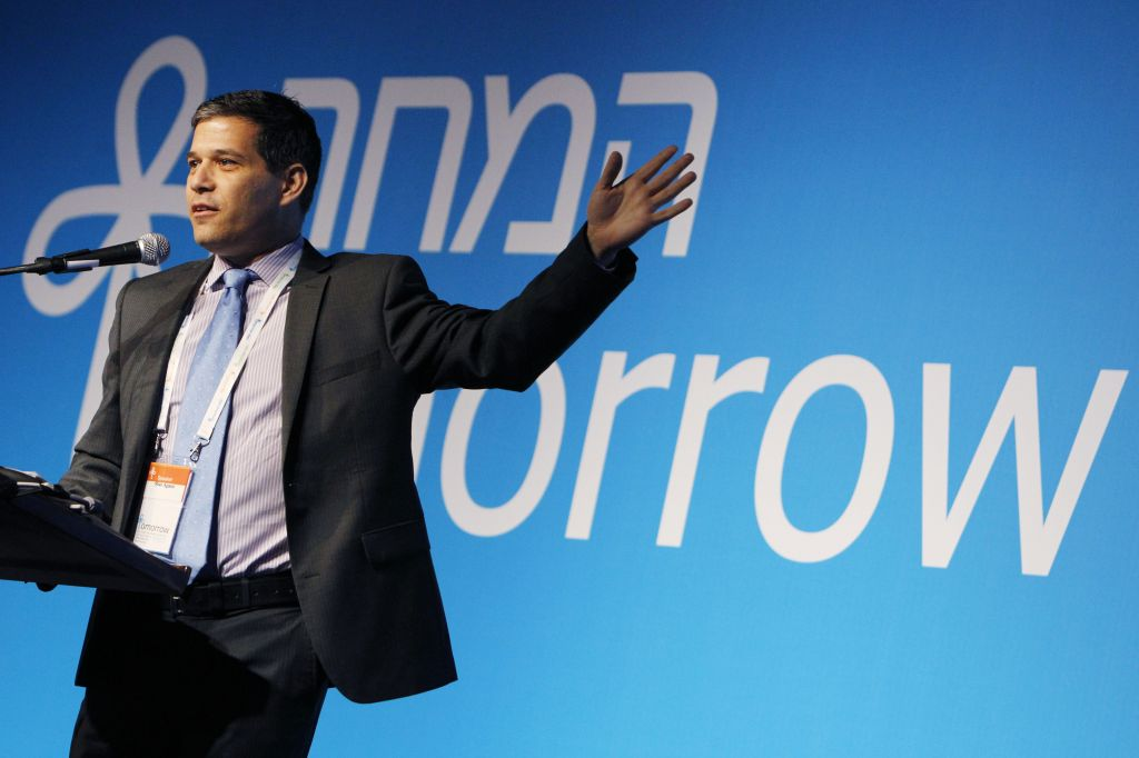 Better Place founder Shai Agassi seen speaking at the recent Peres Presidential Conference, where he spoke about solar power and electric vehicles (photo credit: Miriam Alster/Flash 90)