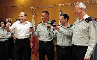 Defense Minister Moshe Ya'alon (left) and chief of the General Staff Lt. Gen. Benny Gantz (right) have unveiled an array of cuts to the defense budget (Photo credit: Ariel Heromni/ Ministry of Defense/ Flash 90)