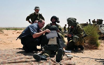 Defense Minister Moshe Ya'alon meeting with soldiers during a visit to the Tze'elim military base on July 9, 2013. (photo credit: Ariel Hermoni/Ministry of Defense/Flash90)