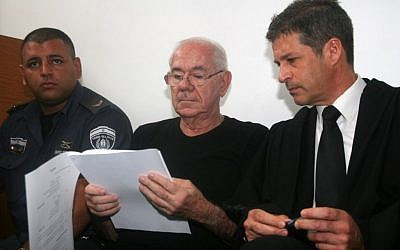 Former judge Dan Cohen (center) with his attorney Eitan Maoz, at court in Tel Aviv, on July 11, 2013. (photo credit: Roni Schutzer/Flash90)