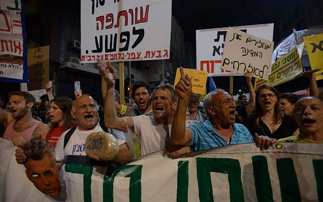Protesters in Tel Aviv Saturday night. (photo credit: Gili Yaari/ Flash90)