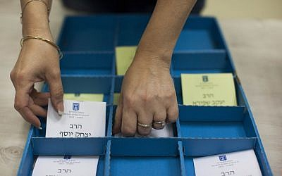A woman arranging voting slips for the Chief Rabbinate election. (photo credit: Yonatan Sindel/Flash90)