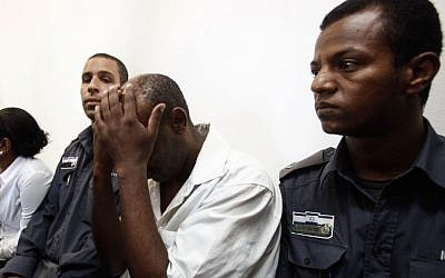A security guard arrested for the shooting of a father/daughter legal team at their family-owned law office Jerusalem, seen in the Magistrate's Court in Jerusalem on July 24, 2013. (photo credit: Flash90)