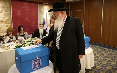 A rabbi casts his vote for the elections of the new chief rabbis of Israel, in Jerusalem on July 24, 2013. (photo credit: Yonatan Sindel/Flash90)