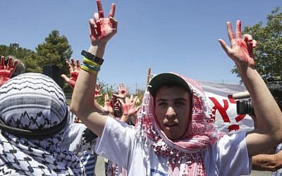 Israelis rallying against a planned prisoner release, with fake blood on their hands. (photo credit: Flash90)