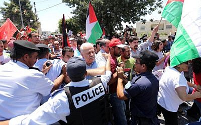 Palestinian riot police clash with protesters demonstrating against renewed peace talks with Israel in the West Bank city of Ramallah, in July 2014. (photo credit: Issam Rimawi/Flash90)