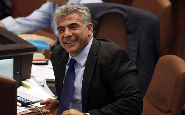 Finance Minister Yair Lapid smiles during the Knesset debate on the 2013-2014 state budget, on July 29, 2013 (photo credit: Flash90)