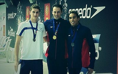 Garrett Weber-Gale (center) with his first Maccabiah gold medal (photo credit: Raphael Gellar)