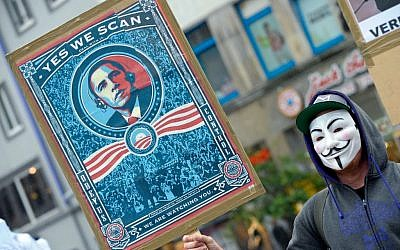 A demonstrator protests with a poster against NSA in Hanover, Germany, Saturday, June 29, 2013 (photo credit: AP/dpa, Peter Steffen)