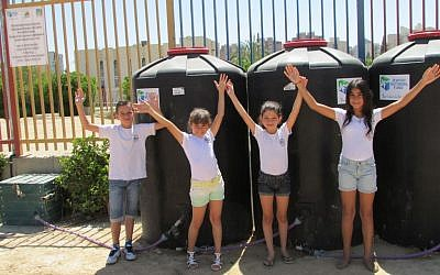 Students at Naot Lonn school in Beersheba show off their school's water recycling system. (photo credit: Debra Kamin/Times of Israel)