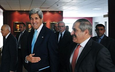 US Secretary of State John Kerry, center, walks with Jordan's Foreign Minister Nasser Judeh at the Ministry of Foreign Affairs in Amman, Jordan, on July 17, 2013. (photo credit: AP/Mandel Ngan)