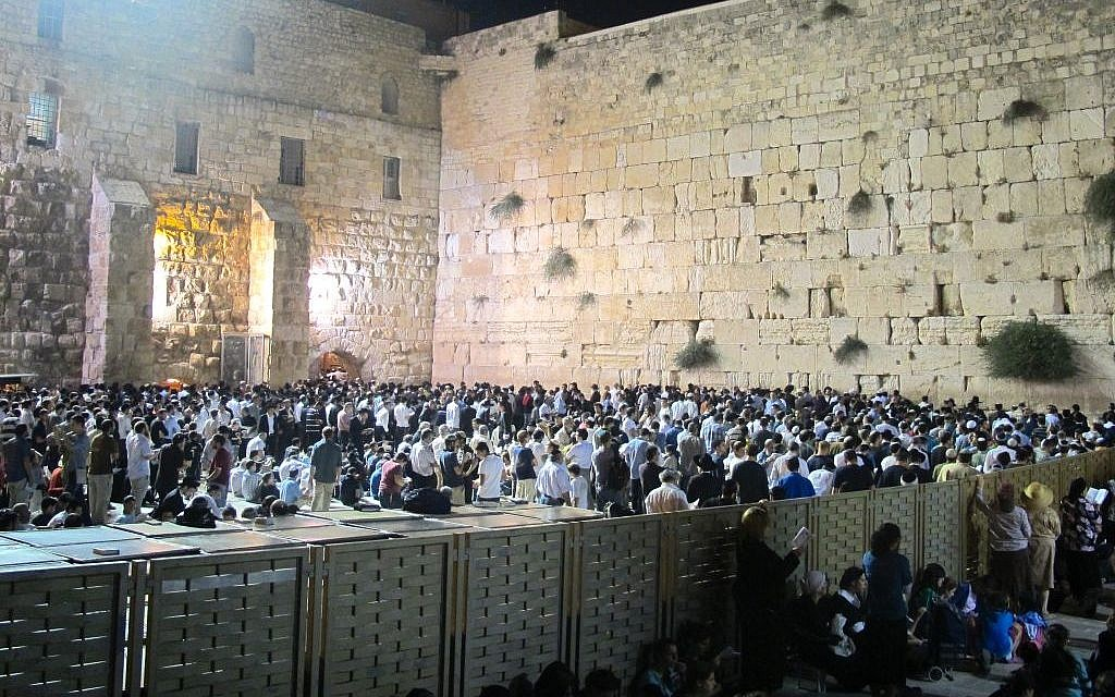 Praying, fasting and mourning the Temple's destruction on the Ninth of Av, Tisha B'Av. (Leeor Bronis/Times of Israel)