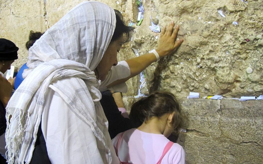 A woman and girl making their way to the Kotel on the ninth of Av (photo credit: Leeor Bronis/Times of Israel)
