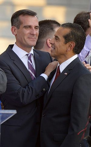 New Los Angeles Mayor Eric Garcetti, left, talks with outgoing mayor Antonio Villaraigosa after his inauguration in front of city hall after being sworn in, Sunday, June 30, 2013, in Los Angeles. (photo credit: AP Photo/Mark J. Terrill)
