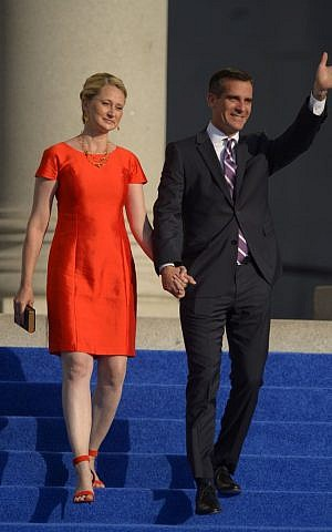 Eric Garcetti, right, waves with his wife Amy Wakeland as they are introduced before he is sworn in as mayor of Los Angeles in front of city hall, Sunday, June 30, 2013, in Los Angeles. (photo credit: AP Photo/Mark J. Terrill)