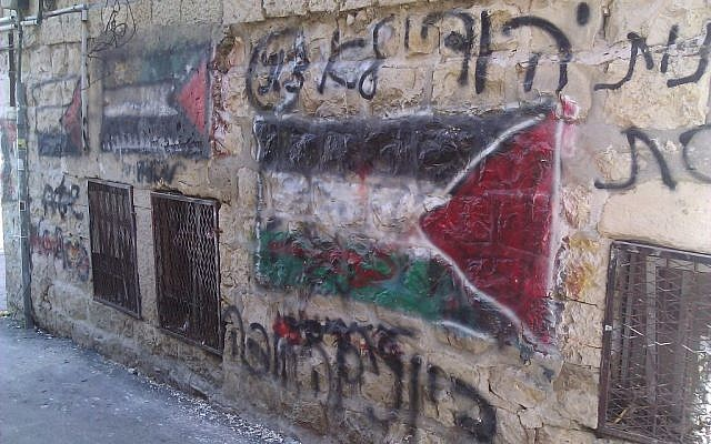 Graffiti depicting a Palestinian flag in a stronghold of the extremist Neturei Karta faction in the ultra-Orthodox neighborhood Mea Shearim (photo credit: Ilan Ben Zion/Times of Israel)