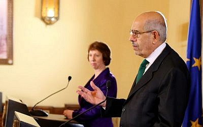 This image released by the Egyptian Presidency shows interim Vice President Mohamed ElBaradei, foreground, making remarks at a joint news conference with EU foreign policy chief Catherine Ashton, center, at the presidential palace in Cairo, Egypt, Tuesday, July 30, 2013 (photo credit: AP)