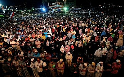 Supporters of ousted Egypt's President Mohammed Morsi perform an evening prayer known as 'Tarawih' during the Islamic month of Ramadan, in Nasr City, Cairo, Egypt on July 10, 2013. (photo credit: AP Photo/Hussein Malla)