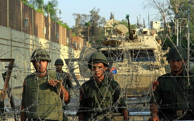 Army troops in front of the presidential palace in Cairo, Egypt, Tuesday, July 2 , 2013 (photo credit: AP/Ahmed Gomaa)