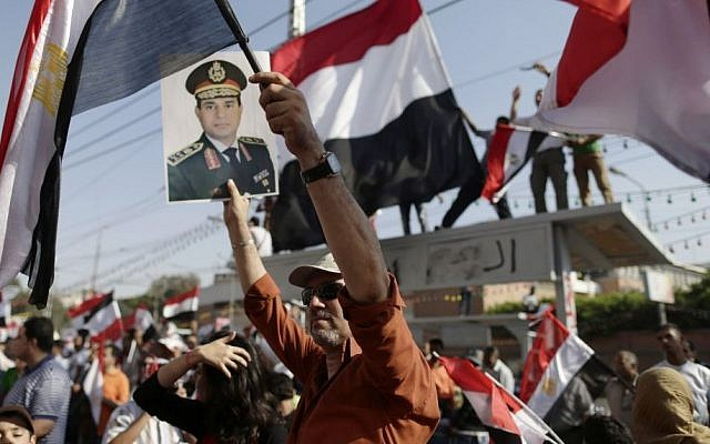 Demonstrators against Egypt's ousted President Mohammed Morsi chant slogans during a protest by the presidential palace in Cairo, Egypt, Friday, July 26, 2013. (Photo credit: AP/Hassan Ammar)