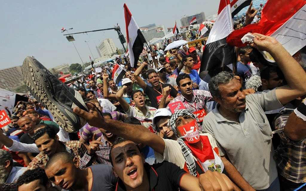 Opponents of Egypt's Islamist President Mohammed Morsi shout slogans during a protest in Tahrir Square in Cairo, Egypt on Wednesday. (photo credit: AP/Amr Nabil)