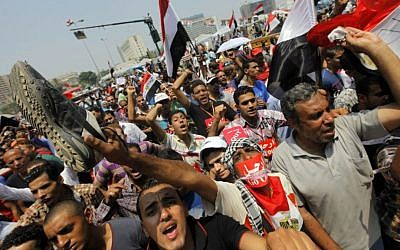 Opponents of Egypt's ousted Islamist president Mohammed Morsi shout slogans during a protest in Tahrir Square in Cairo, Egypt, July 3, 2013 (photo credit: AP/Amr Nabil)