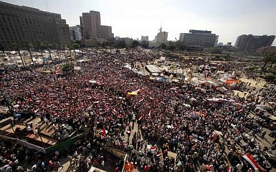 Opponents of Egypt's Islamist president Mohammed Morsi at a protest in Tahrir Square in Cairo, Egypt, on Wednesday. (photo credit: AP/Amr Nabil)