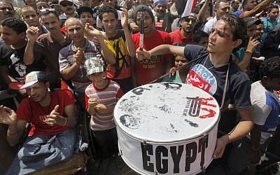 Egyptian protesters shout slogans and wave national flags during a demonstration against Egypt's Islamist President Mohammed Morsi in Tahrir Square in Cairo, Monday, July 1, 2013 (AP Photo/Amr Nabil)