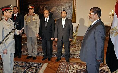 Egyptian President Mohammed Morsi swears in newly-appointed Minister of Defense, Lt. Gen. Abdel-Fattah al-Sisi, in Cairo, Egypt last August (photo credit: AP/Egyptian Presidency)