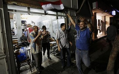 Egyptians celebrate at a tea house at Defense Minister Gen. Abdel-Fattah el-Sissi's announcement in Cairo's Zamalek district Wednesday, July 3 (photo credit: AP/Hiro Komae)