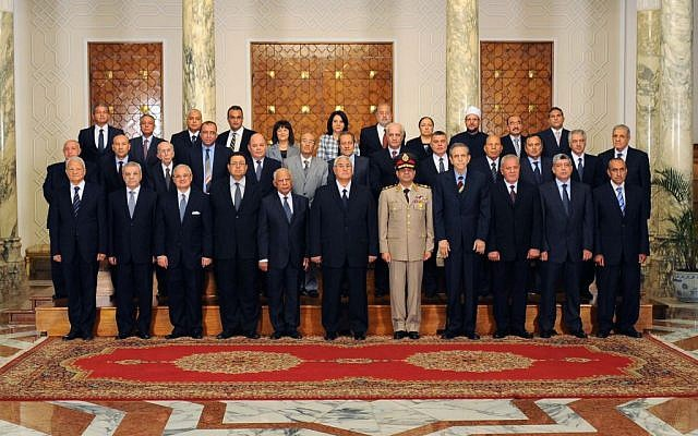 Interim President Adly Mansour, center, with his new cabinet ministers at the presidential palace in Cairo, Egypt on Tuesday, July 16 (photo credit: AP/Egyptian Presidency)