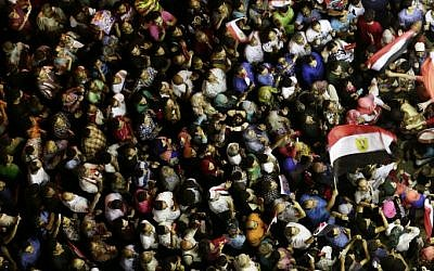 Opponents of Egypt's Islamist President Mohammed Morsi protest near the presidential palace, in Cairo, Egypt, Sunday, June 30, 2013. (photo credit: AP/Hassan Ammar)