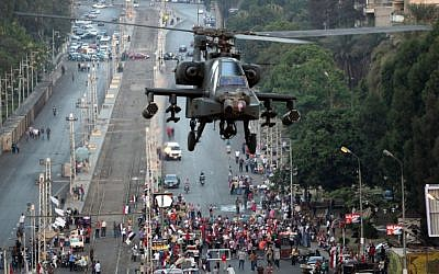 A military attack helicopter flies near the presidential palace in Cairo, Egypt, Friday, July 5 (photo credit: AP/Khalil Hamra)