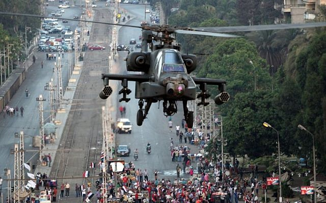 A military attack helicopter flies near the presidential palace in Cairo, Egypt (photo credit: AP/Khalil Hamra/File)